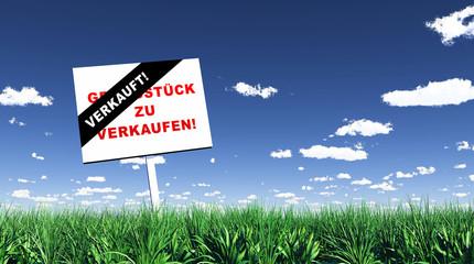 Schild im Gras - Grundstück verkauft