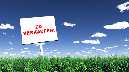 Schild im Gras - Zu verkaufen