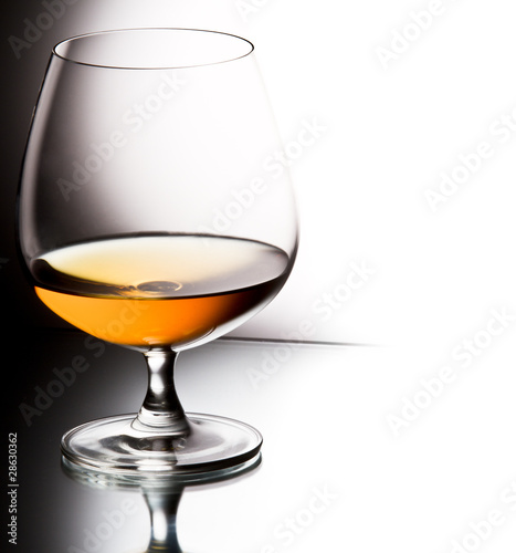 Glass of brandy over white background