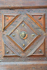 Italy Ferrara medieval door decoration