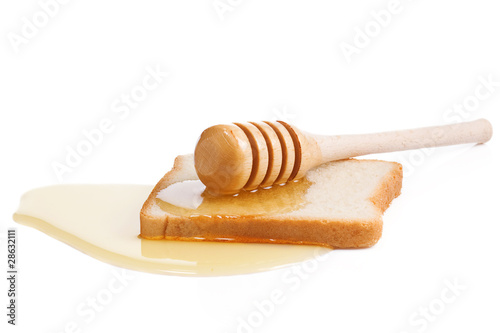 honey and bread isolated on white