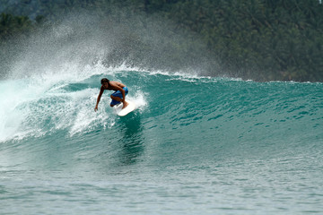 Speed surfer on tropical green wave