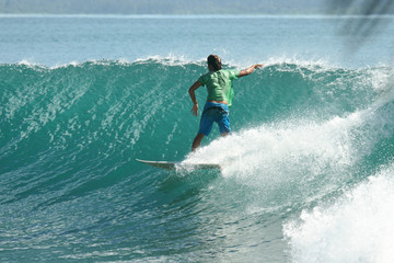 Surfer on perfect green wave