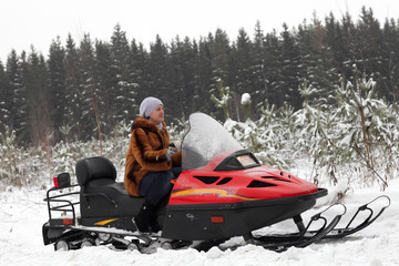 Portrait of woman on snowmobile