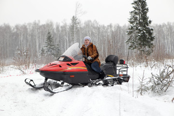 Russian woman driving snowmobile