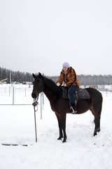 Woman on horseback in winter