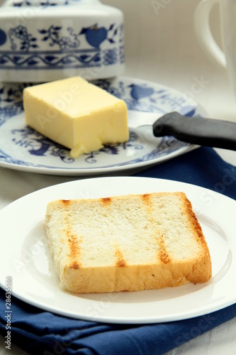 fresh yellow butter on toast for breakfast