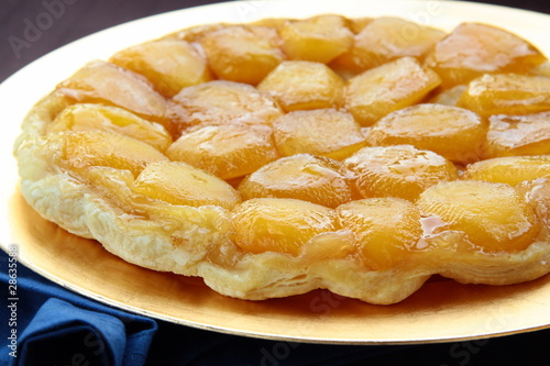 Beautiful delicious apple pie on a gold plate