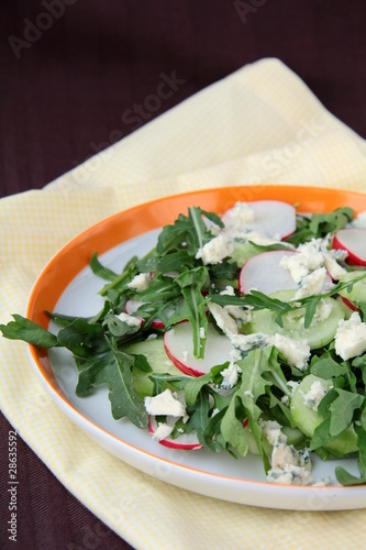 Fresh vegetable salad of cucumbers and radishes