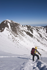 mountain climber on snow with beautiful winter scenery.