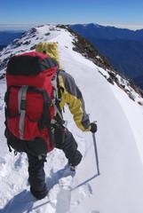 mountain climber on snowy summit.