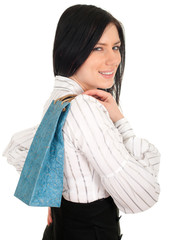 young, elegant woman keeping blue present bag