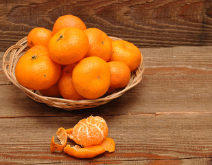 ripe tangerine fruits in basket