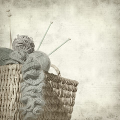 textured old paper background with knitter's basket with unfinis