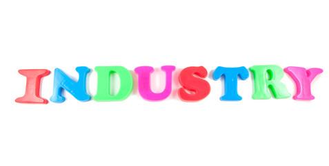 industry written in fridge magnets on white background
