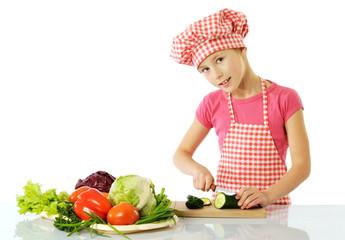 Little girl preparing salad