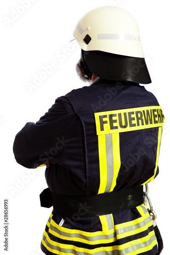 Feuerwehrmann, mit dem Rücken zur Kamera stehend