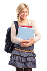 Smiling female student with a school bag holding books