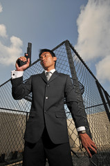 Asian Chinese Man carrying a Pistol