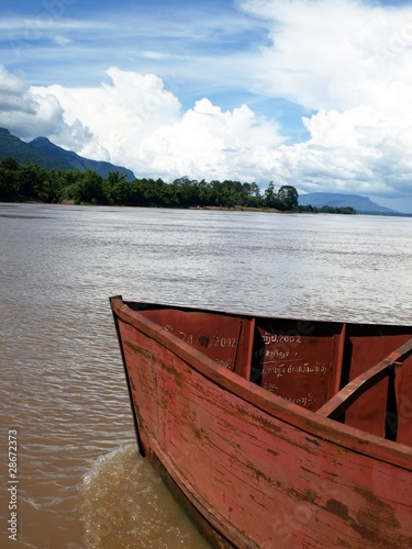 old red boat on the river, Lao