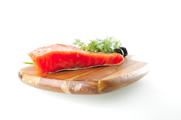 pink salmon on wooden plate with cheese