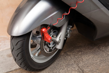 Red lock on motorbike