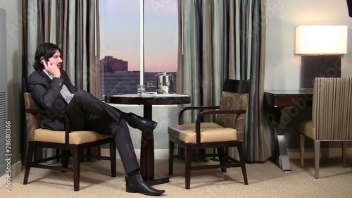 Businessman on cellphone in hotel room - HD
