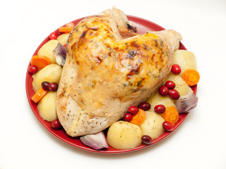 Turkey crown with stuffing, cranberries and vegetables