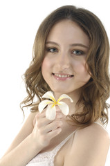 Portrait of a cute young woman holding flower and smiling