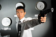 Asian Man with a Gun pointing dangerously