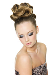 Teen girl with fashion hairstyle and glamour make-up
