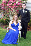 Smiling Prom Couple Sitting In Yard
