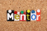 The word Mentor in magazine letters on a notice board poster