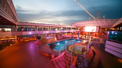 Open-air water pool on deck of cruiser in night
