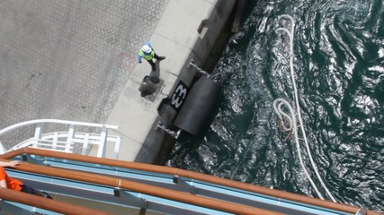 workers near cleat is fitting on ships boats and docks