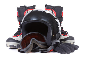 Boots for snowboarding and a protective helmet