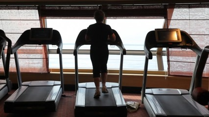 unidentified woman workout on treadmill running in gym