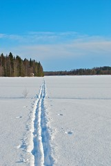 Ski tracks on a snow, beautiful winter day.