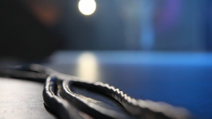 wires of audio equipment on floor of stage of concert hall