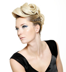 Beautiful  woman with modern hairstyle and blue make-up
