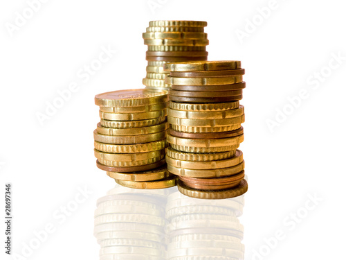 Piles of euro coins on white background