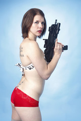 Woman in lingerie with an assault gun