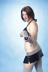 Sexy young woman with a shotgun