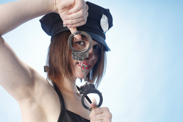 Female police officer playing with handcuffs