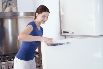 woman opening the refrigerator