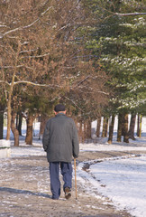 Old man in a winter walk