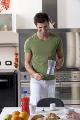 man in the kitchen preparing breakfast