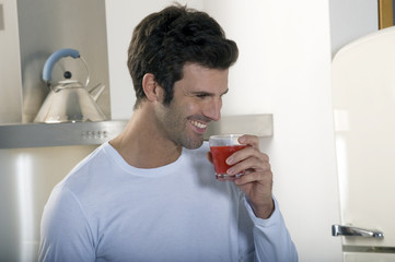 man drinking orange jice