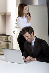 couple at home  with laptop and mobile