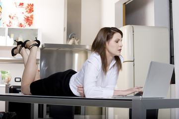 woman in the kitchen with laptop